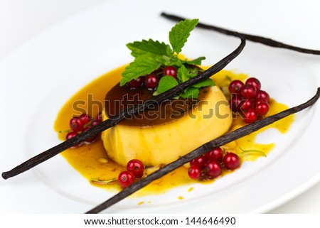 Creme Caramel with red Currants, isolated on White - stock photo