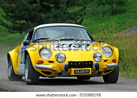 Cremona / Italy -  September 7, 2005 - Unidentified drivers on a yellow vintage Alpine Renault racing car