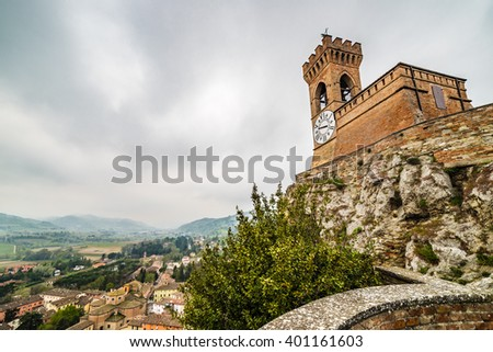 crenellated clock tower above the roofs in the old town of Brisighella in the valley nestled among the hills of Emilia Romagna in Italy