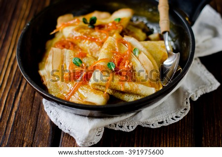 Crepe suzette, traditional french pancakes with orange syrup - stock photo