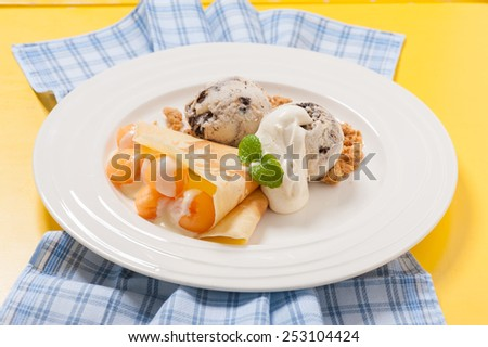 crepe with ice cream and fruit - stock photo
