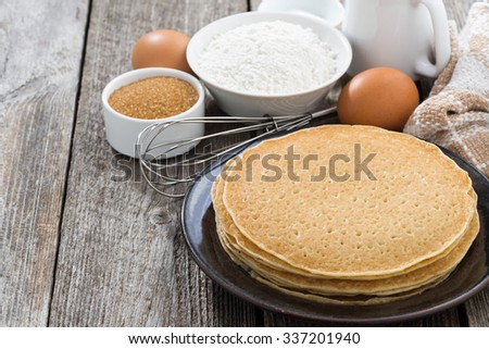crepes and ingredients for their preparation, close-up, horizontal