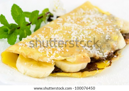 crepes filled with chocolate, banana and coconut - stock photo