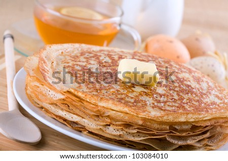 crepes or pancakes with butter - stock photo