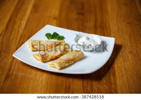 crepes stuffing plate background wooden table - stock photo