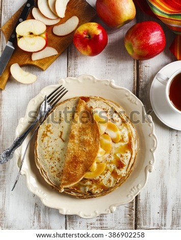 Crepes with apple and caramel sauce