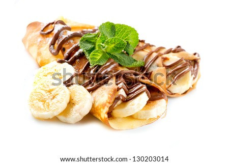 Crepes With Banana And Chocolate - stock photo