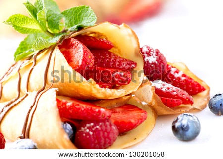Crepes With Berries. Crepe with Strawberry, Raspberry, Blueberry and Chocolate topping - stock photo