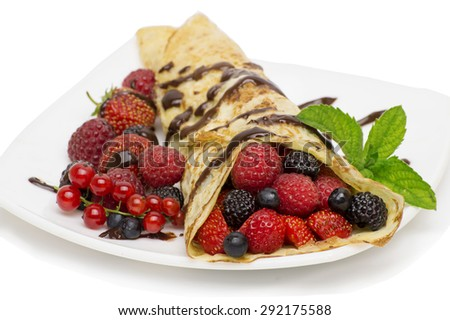 Crepes With Berries.Crepe with Strawberry, Raspberry, Blueberry and Chocolate topping.Pancake - stock photo