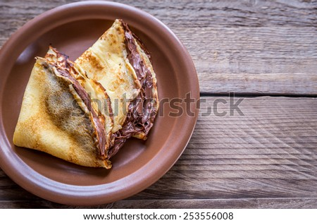 Crepes with chocolate cream - stock photo