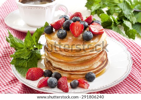 Crepes with  fresh berries. Pancakes stack with strawberry, blueberry and syrup - stock photo