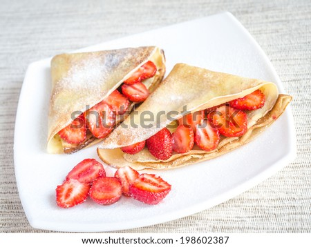 Crepes with fresh strawberries