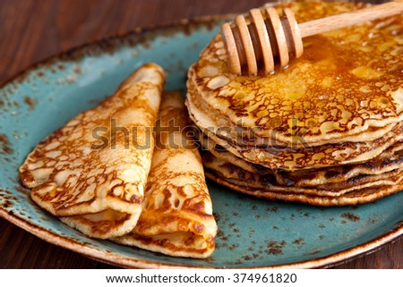 Crepes with honey. Pancake week, mardi gras, maslenitsa holidays - stock photo