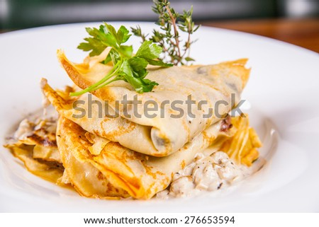 Crepes with mushrooms - stock photo
