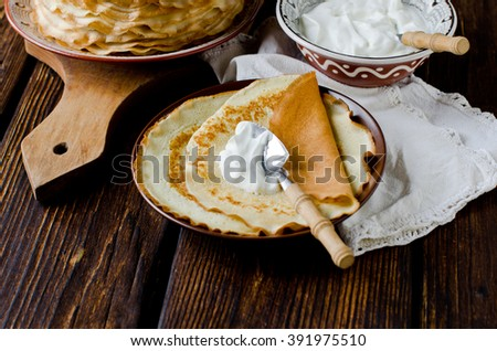 Crepes with sour cream - stock photo