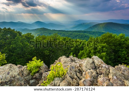 Crepuscular rays over the Blue Ridge Mountains seen from Loft Mountain in Shenandoah National Park, Virginia. - stock photo