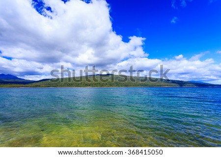 Crescent Lake in Central Oregon is extremely clear due to spring creek water runoff. - stock photo