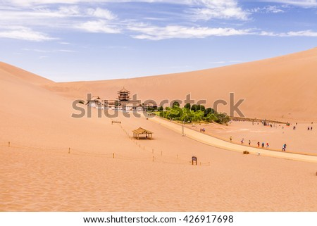 Crescent Lake(Moon Lake) a natural wonder in the Gobi Desert, south of the Dunhuang city, Gansu Province, Western China. - stock photo