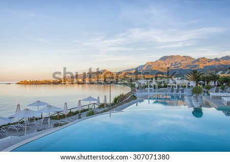 CRETE, GREECE - MAY 2015: Sunrise view on luxurious swimming pool in Greek spa hotel at Makrigialos on Crete island. - stock photo