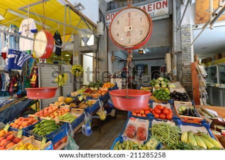 CRETE, HERAKLION - AUGUST 09: Unknown people sell fresh fruits in Heraklion, Crete, Greece on 09 August 2014. Heraklion, the capital of the island of Crete, Greece - stock photo