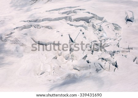 Crevasses on the slope of jungfrau and  Rottalhorn mountains in Jungfrau region - stock photo