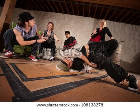 Crew of break dancers in underground setting - stock photo