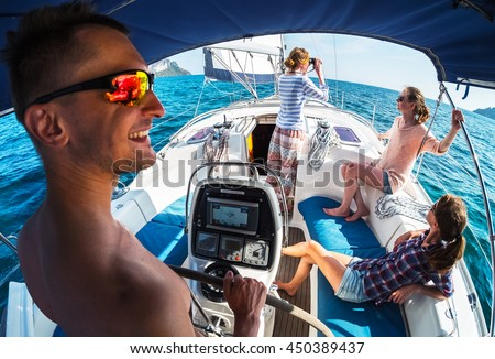 Crew of young friends sailing in a blue sea on the yacht