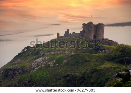 Criccieth Castle at sunset. Medieval castle on the Llyn peninsula, North Wales, UK