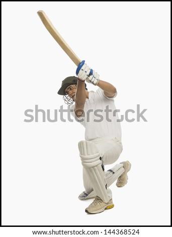 Cricket batsman playing a cover drive - stock photo