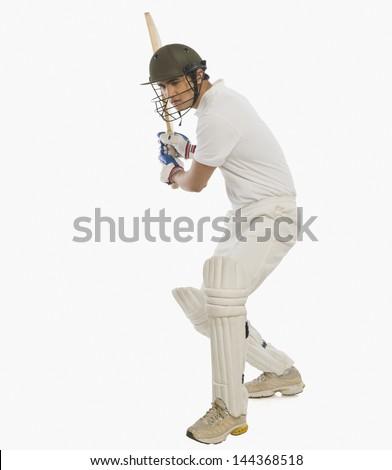 Cricket batsman playing a stroke - stock photo