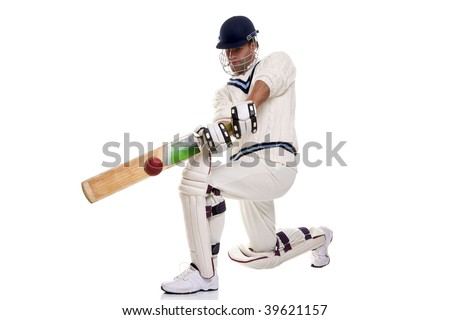Cricketer down on his knee playing a shot, studio shot on white background.