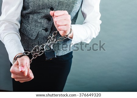 Crime, arrest jail or business concept. Closeup woman with chained hands on grunge background - stock photo