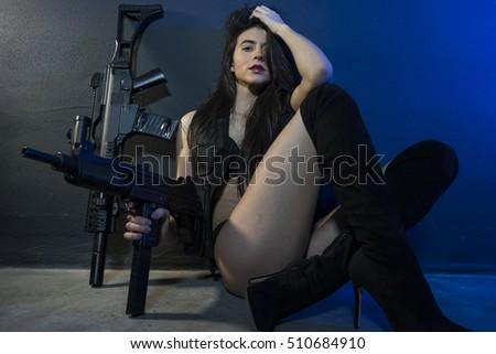 girl holding gun in underwear