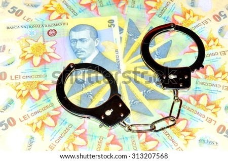 Crime concept with Romanian currency (lei) and handcuffs - stock photo