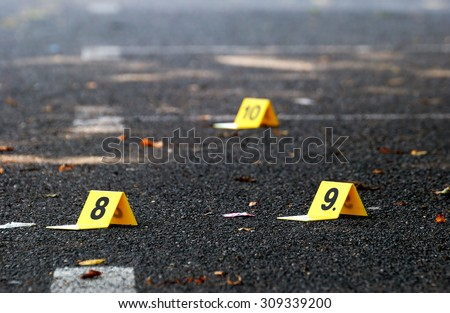 Crime Evidence Markers on Asphalt - stock photo