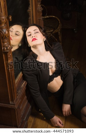 Crime scene. Dead business woman dressed black suit in the closet
