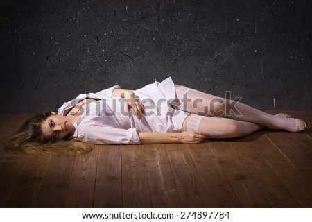 Crime scene. Dead nurse lying on the floor. Low key - stock photo