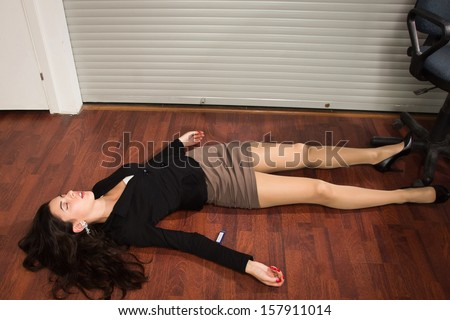 Crime scene in a office with lifeless businesswoman lying on the floor  - stock photo