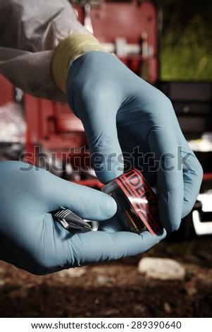 Crime scene investigation - evidence of pistol cartridge - stock photo