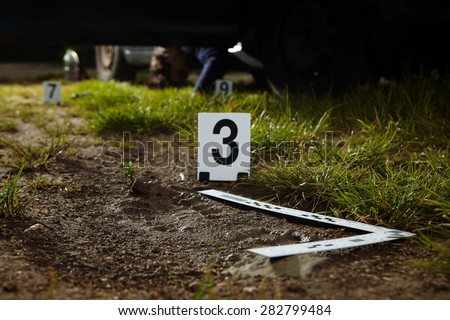 Crime scene investigation - footprint of murder on way - stock photo
