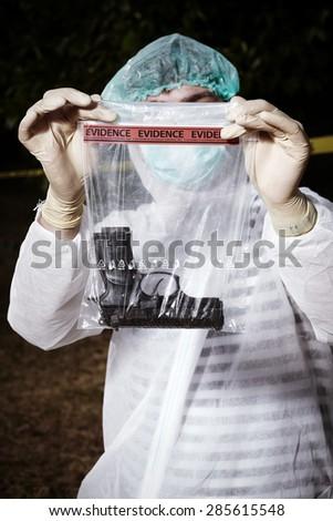 Crime scene investigation - handgun as evidence of crime - stock photo