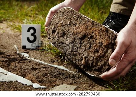 Crime scene investigation - lifting of footprint - stock photo