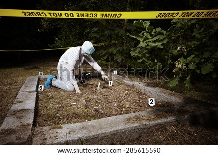 Crime scene investigation - photographer on place of crime - stock photo