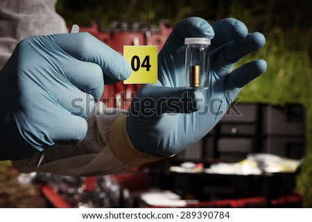 Crime scene investigation - pistol ammunition evidence - stock photo