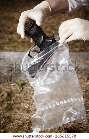 Crime scene investigation - pistol in park found - stock photo