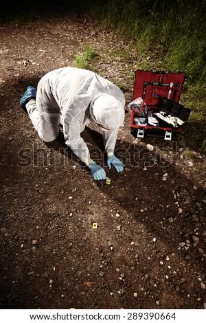 Crime scene investigation - technician criminologist on crime scene - stock photo