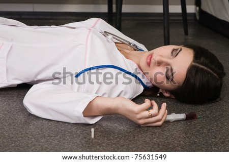 Crime scene. Nurse lying on the floor