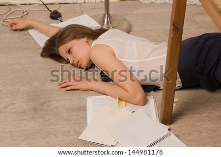 Crime scene simulation. Body of the lifeless college girl - stock photo