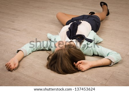 Crime scene simulation: college girl lying on the floor