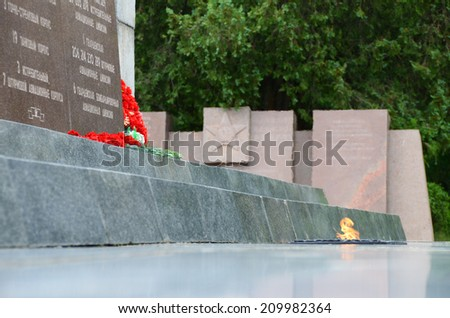 CRIMEA - CIRCA JUNE 2014: Eternal Flame of the Sapun-Mountain Memorial Complex, Sevastopol dist., June 2014. Eternal Flame of the Martial Glory Obelisk in memory of the Soviet Army feat during WWII. - stock photo